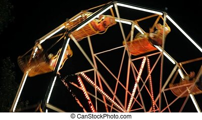 Park Ferris Wheel In The Night - The old carousel in a small...