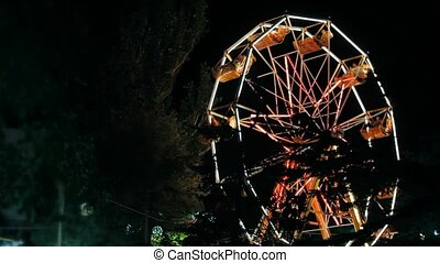 The old carousel in a small provincial park at night. - In...
