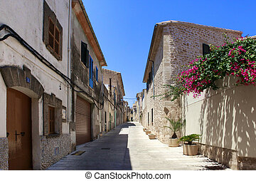 Alcudia Old Town - The narrow street in the old town of...