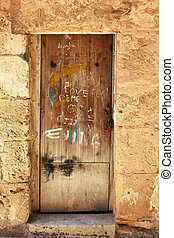 Alcudia Old Town - Wooden door of an old stone house in...