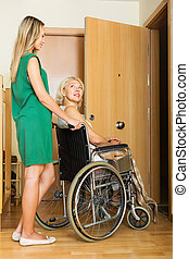 Social worker and disabled female - Friendly social worker...