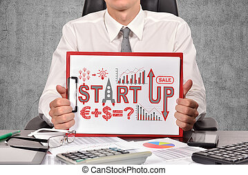 start up - businessman holaing clipboard with drawing start...