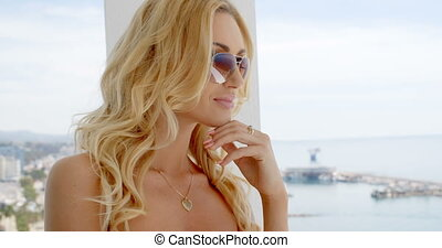 Blond woman wearing mirrored sunglasses - Blond attractive...