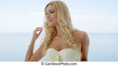 Blond Woman on Ocean Front Balcony Looking to Side - Waist...