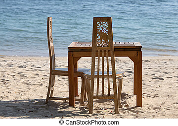 Table and chairs with a beautiful sea view on island Koh...