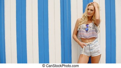 Blond Woman in front of Striped Beach House - Three Quarter...