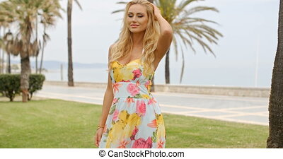 Blond Woman in Sun Dress at Ocean Front Promenade - Waist Up...