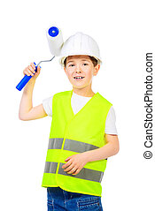 builder boy - A boy in a costume of a builder posing with...