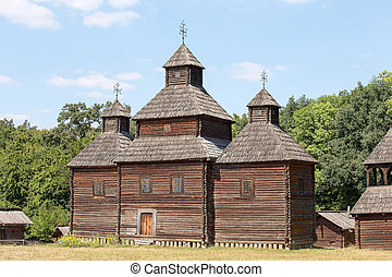 Wooden ukrainian antique orthodox church in summer Pirogovo...