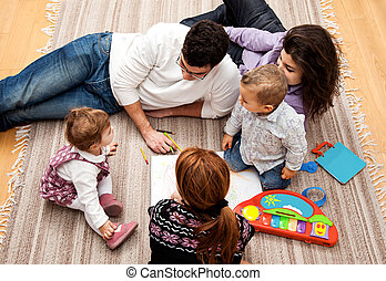 family education group - family group of five on the floor -...