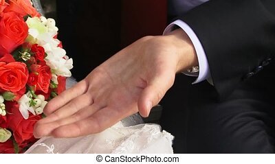 Man And Woman Joined Hands. - Bride and groom holding hands