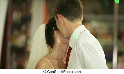 First Wedding Dance - Bride and groom dancing in a...