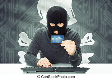 Hacker holding credit card and flag on background - Jolly...