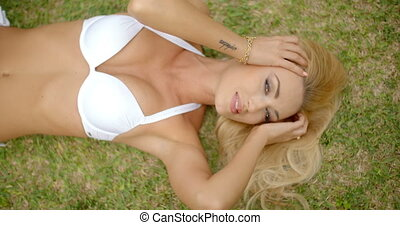 Blond Woman in White Bikini Lying on Grass - Looking Down at...