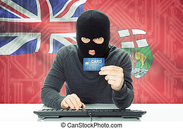 Hacker holding credit card and Canadian province flag on...
