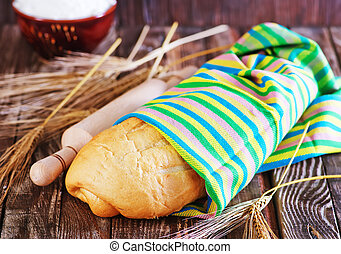 bread in napkin and on a table