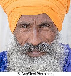 Portrait of Indian sikh man in turban with bushy beard....