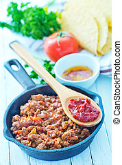 minced meat with tomato sauce in the pan