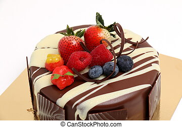 chocolate cake with strawberry topping. - Rich milk...