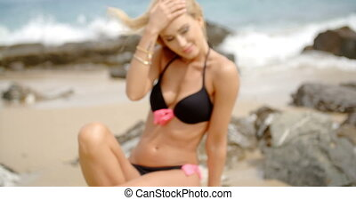 Blond Woman with Hand in Hair on Rocky Beach - Close Up Head...