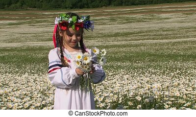 Cute Little Girl With Chamomiles In The Field - This is a...