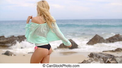 Blond Woman in Bikini and Cover Up on Rocky Beach -...