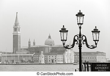 Venice in sepia - Gondola ride stop and street lamp at...