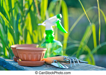 garden tools on the wooden background in the garden