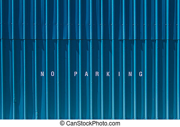 No Parking - No parking printed on blue siding.