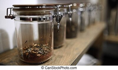 Focus back and forth on the vintage jars with tea(old)