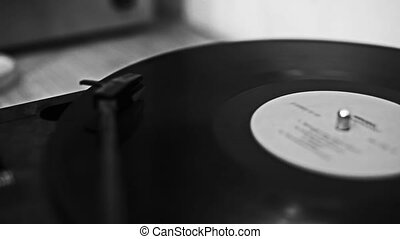Vintage record plays vinyl old melody - old turntable plays...