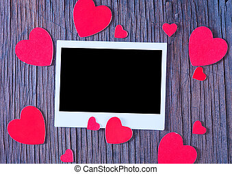background - paper heart and photo on the wooden background