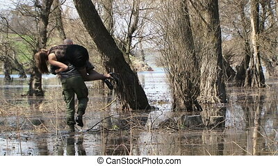 Man Carries Model On Shoulders To Stump In Flood At Grove -...