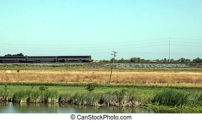 Amtrack Train Engine And Four Cars - Passenger Train Moving...