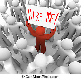 Person Holding Hire Me Sign in Crowd - A red person stands...