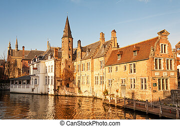 Bruges cityscape - Typical houses around Dijver canal in...
