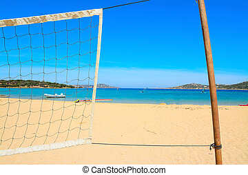 beach volley net by the sea in Porto Pollo, Sardinia