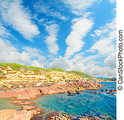red rocks and blue sea - red rocks by the sea in Sardinia,...