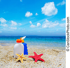 bottles and starfish by the sea - suntan lotion bottles and...
