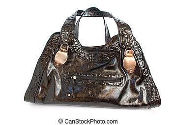 black female shiny bag isolated on white