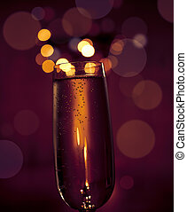 Sparkling wine - Glass of sparkling wine with blurred lights...