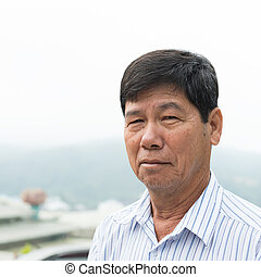 Asian senior citizen - Portrait of Asian senior man outdoor...