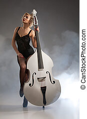 Young Woman In Lingerie With A Double Bass - Young woman in...