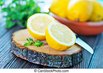 lemon and mint on the wooden table