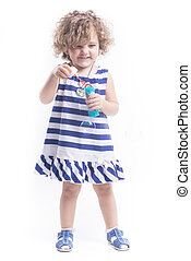 femal child with soap bubbles - Blonde femal child with soap...