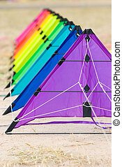 Kites on the ground - A stack of stunt kites in rainbow...