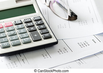Financial statement with calculator and glasses - Close up...
