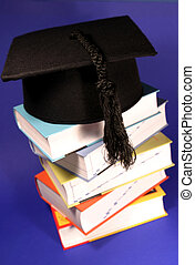 graduation hat with books - graduation hat on a stack of...