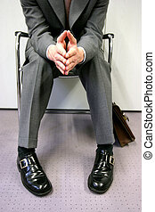 job interview - Person sitting impatiently, waiting for a...