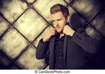 forceful - Vogue shot of a handsome man in black suit posing...